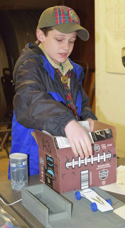Spectrum/Arrow of Light Carter Brandel of Cub Scout Pack 467 in New Milford checks in his car at the start of the pack's pinewood derby Jan. 28, 2018 at the Odd Fellows Hall. Carter's car won third place in his den and first place in the pack's final championship race. Photo: Deborah Rose / Hearst Connecticut Media / The News-Times  / Spectrum