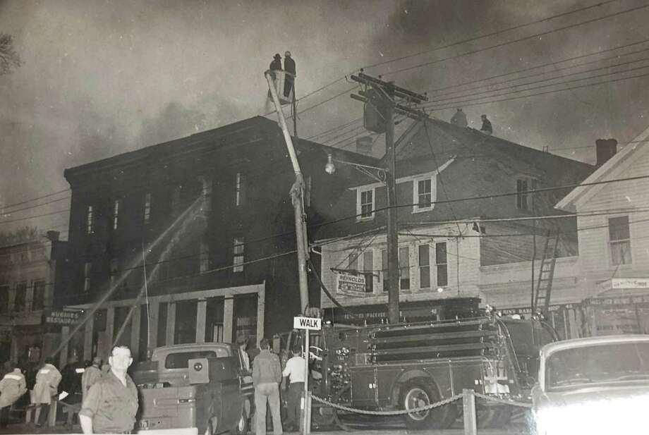 The towns that make up the Greater New Milford area have had their share of fires over the years. For example, the Great Fire of 1902 destroyed virtually every building in New Milford's commercial block from Bridge Street to Bank Street. In days and weeks to follow, the small farming community began to take steps to recover from such a devastating blow to its economy, and the town recovered. Sixty years later, firefighters were called to Railroad Street to respond to a fire, as shown in this 1962 photograph of first responders battling smoke. If you have a Way Back When photo youd like to share, contact Deborah Rose at drose@newstimes.com or 860-355-7324. Photo: Courtesy Of Sally Day / The News-Times Contributed