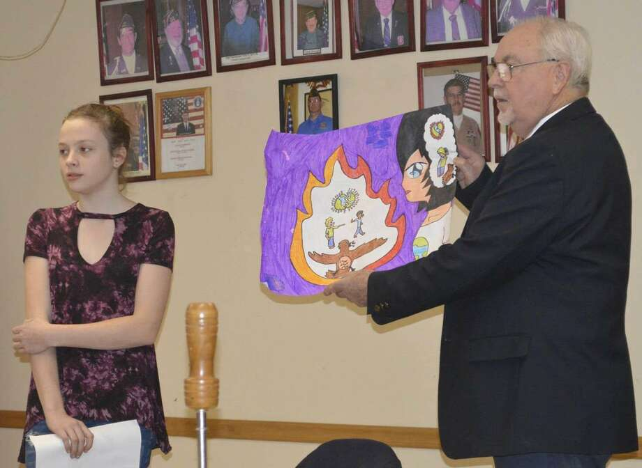 Keira Sosbe, a sixth grader at Schaghticoke Middle School in New Milford, was named winner of the local 2017 Peace Poster contest sponsored by the Lions Club. Photo: Courtesy Of New Milford Lions Club / The News-Times Contributed