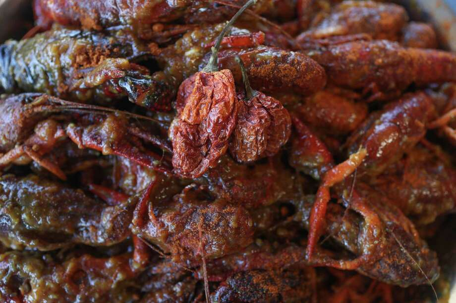 Casian Crawfish Reaper Pepper Casian Crawfish photographed Monday, Jan. 29, 2018, in Houston. Casian Crawfish is a new Vietnamese crawfish restaurant that is out to make the hottest/spicy Vietnamese crawfish in Houston. They have put on their menu a challenge for customers to eat their Reaper Crawfish -- crawfish bathed in a buttery sauce flavored with Carolina Reaper pepper. Most people are familiar with the Ghost Pepper, which is slightly over 1 million Scoville units, the measurement of chile pepper heat. The Carolina Reaper is 2.2 million Scoville units. ( Steve Gonzales / Houston Chronicle ) Photo: Steve Gonzales, Houston Chronicle / © 2018 Houston Chronicle