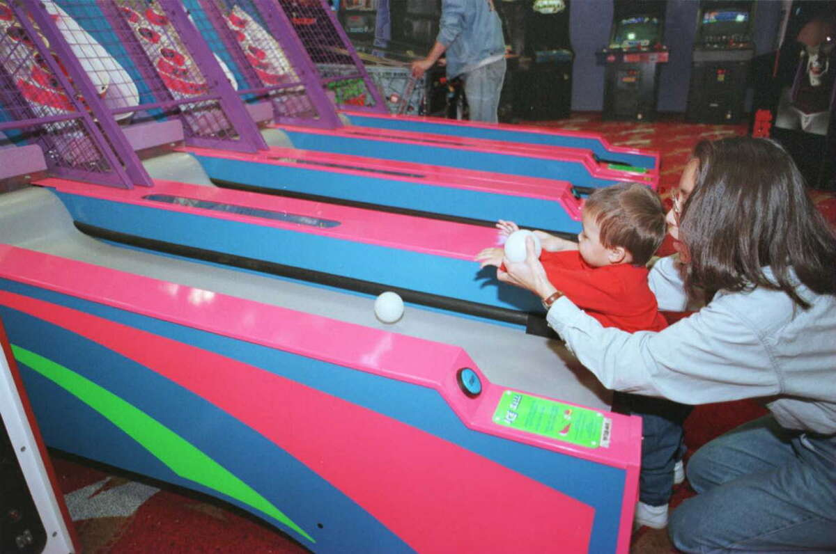 Ethan Molschomann, 15 months old, and his mom, Joanne, play in the game room of the FYE store in Colonie Center in 1997.