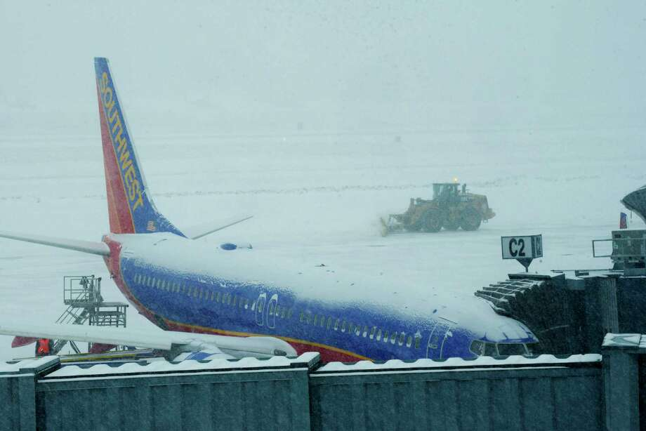 A large snow plow is used to clear snow at the Albany International Airport on Wednesday, Feb. 7, 2018, in Colonie, N.Y. (Paul Buckowski/Times Union) Photo: STAFF, Albany Times Union / (Paul Buckowski/Times Union)