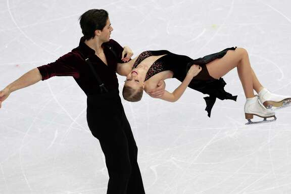 Kaitlyn Weaver and Andrew Poje of Canada compete at the Iceberg Skating Palace during the 2014 Winter Olympics in Sochi, Russia. They finished seventh.