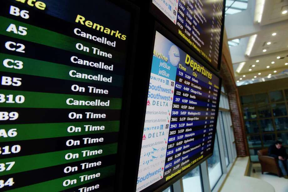 A view of the display that shows planes arriving and departing at the Albany International Airport on Wednesday, Feb. 7, 2018, in Colonie, N.Y.  Some flights were canceled due to the snow storm.  (Paul Buckowski/Times Union) Photo: STAFF, Albany Times Union / (Paul Buckowski/Times Union)