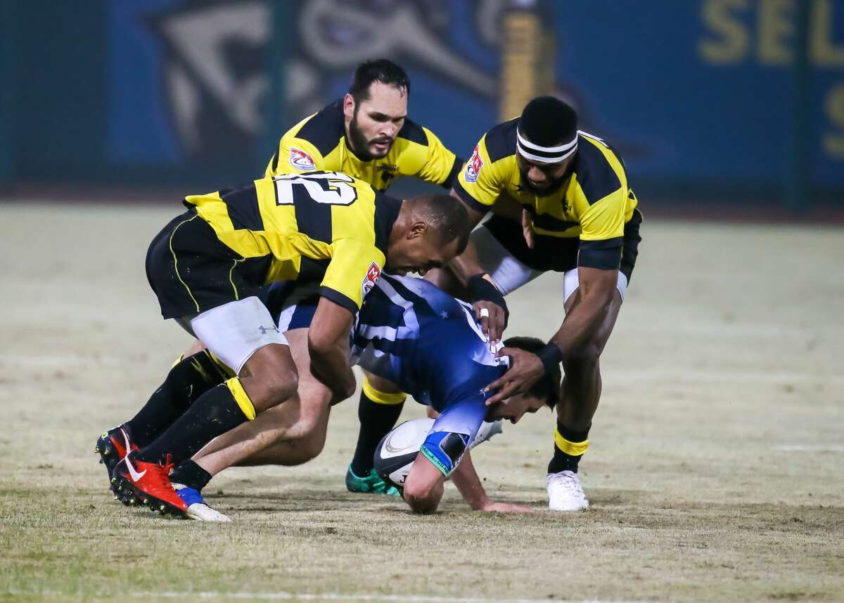 SUGAR LAND, TX - FEBRUARY 03: Houston SaberCats center Osea Kolinisau (12) and Houston SaberCats wing Josua Vici (11) tackle Capital Selects fullback Nick Kuhl (15) during the Major League Rugby match between the Capital Selects and Houston SaberCats on February 3, 2018 at Constellation Field in Sugar Land, Texas. (Photo by Leslie Plaza Johnson/Icon Sportswire via Getty Images)