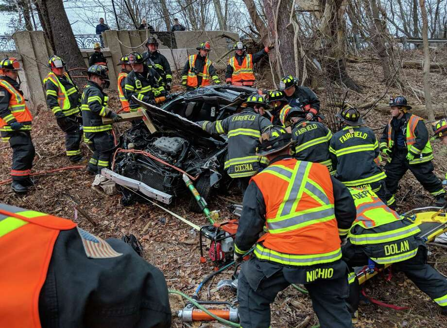 A driver was injured after their car went down an embankment near the North Avenue overpass. off the Merritt Parkway Wednesday, February, 7, 2018. The accident forced the shutdown of all southbound lanes for about 20 minutes between Exit 44 and 42. Westport and Fairfield firefighters used hydraulic rescue tools to perform the extrication of the driver. Photo: Westport Fire Dept. / Contributed Photo / Connecticut Post Contributed