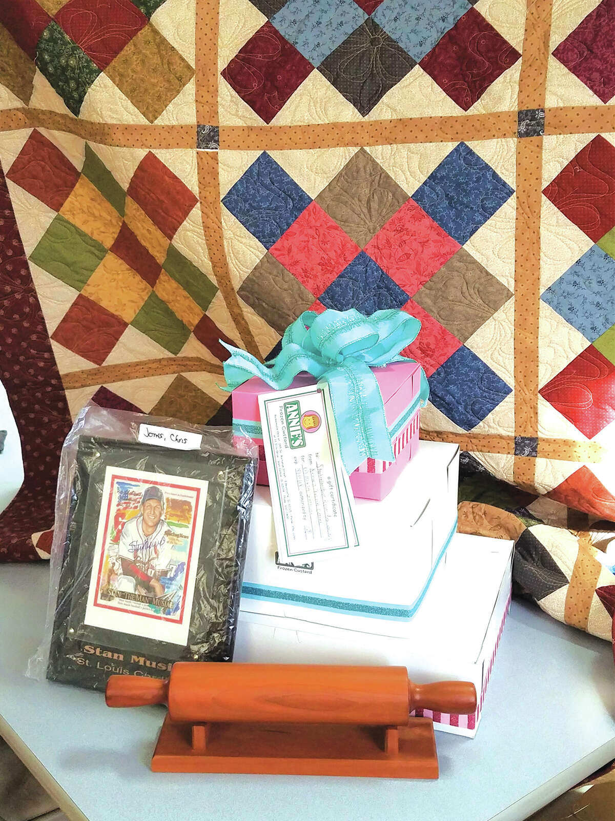 A quilt from Jen Mercer, cakes from Annie's Frozen Custard, a wooden rolling pin, and a signed Stan Musial print are among items that will be auctioned off on Feb. 17.