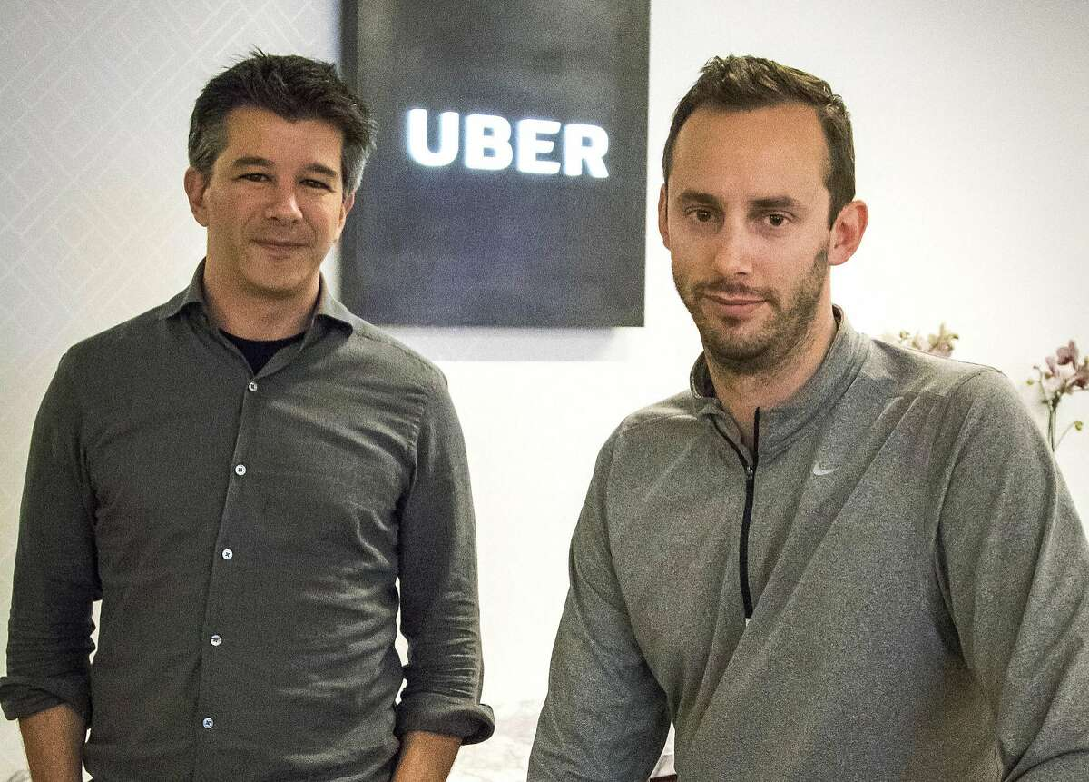 FILE - In this Aug. 18, 2016, file photo, Uber CEO Travis Kalanick, left, and Anthony Levandowski, co-founder of Otto, pose for a photo in the lobby of Uber headquarters, in San Francisco. Former Uber CEO Kalanick returned to a courtroom Wednesday, Feb. 7, 2018, to deal with questions about his discussions with Levandowski, an engineer accused of stealing Google�s self-driving car technology. (AP Photo/Tony Avelar, File)