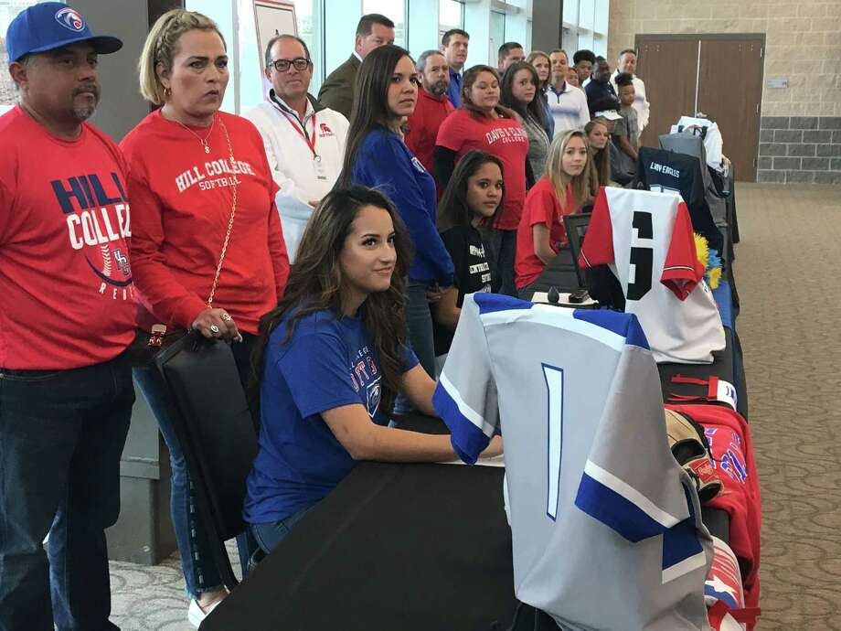 New Caney softball player Fatima Aranda prepares to sign her National Letter of Intent Hill College during New Caney ISD Signing Day at Texan Drive Stadium on Wednesday, Feb. 7, 2018. Photo: Rob Tate