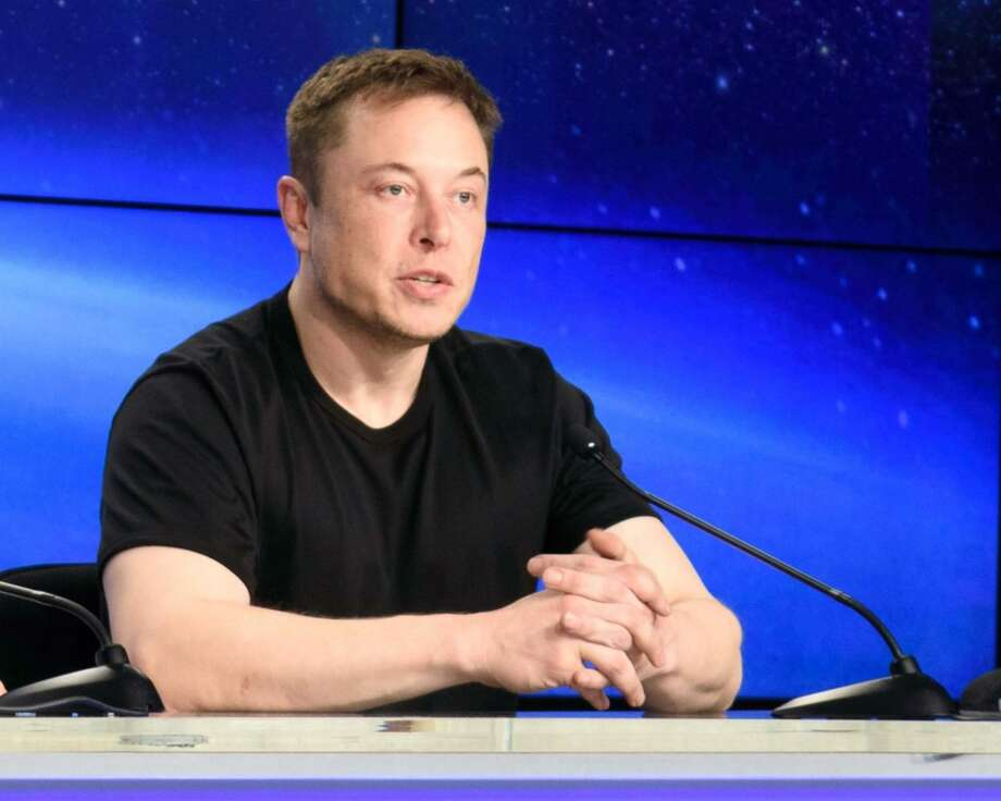 SpaceX CEO Elon Musk meets the press at NASA's Kennedy Space Center. Photo: Alan Boyle/GeekWire