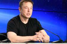 SpaceX CEO Elon Musk meets the press at NASA's Kennedy Space Center.