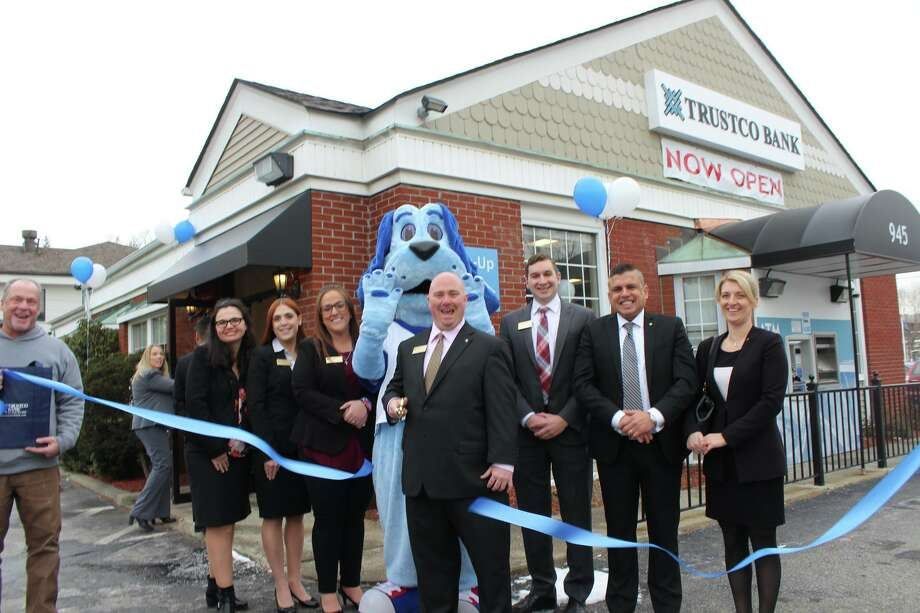 Trustco Bank opened its first branch in Putnam County in December in Mahopac. The local chamber of commerce held this ribbon cutting. Photo: Mahopac-Carmel Chamber Of Commerce.