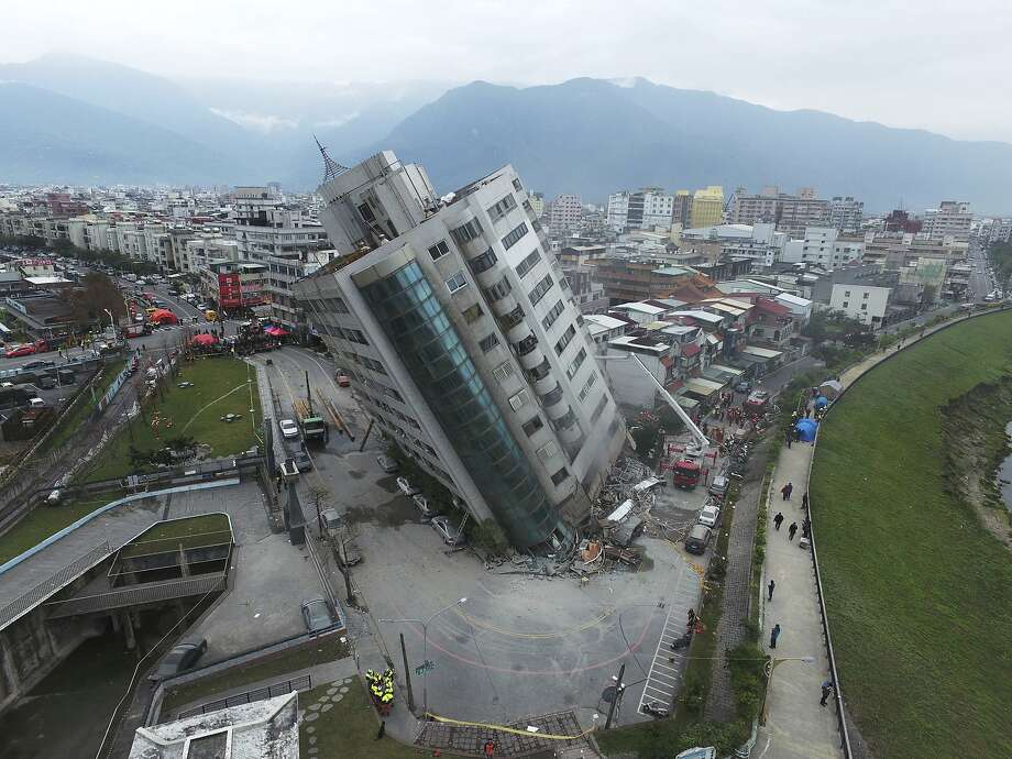 A residential building rests at an alarming angle following an magnitude-6.4 quake earthquake in Hualien, southern Taiwan. Rescue crews continue to search night and day for survivors. Photo: Associated Press