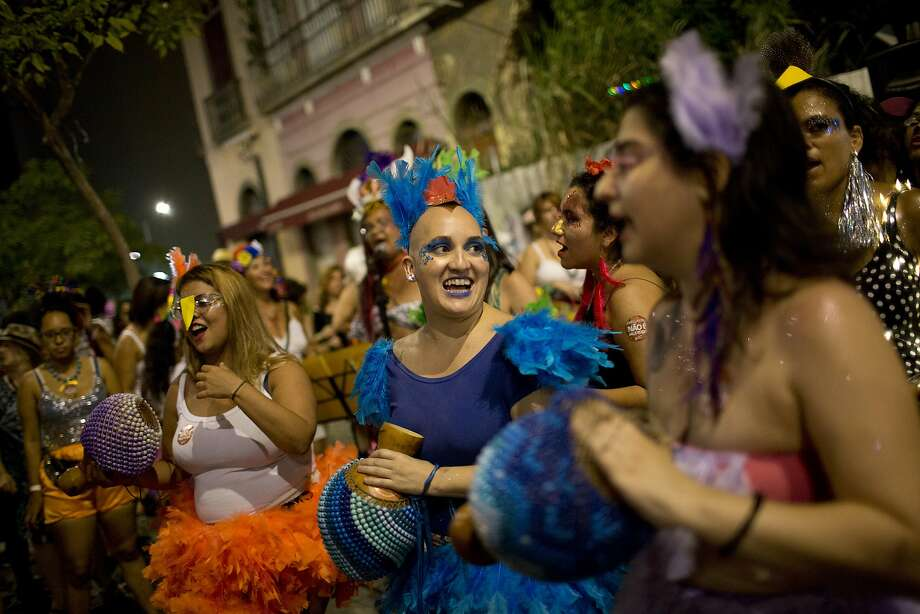 Women play instruments as they take part in Carnival festivities in Rio de Janeiro. Many women are using the celebrations as a time for a public dialogue on sexual harassment and gender-based violence. Photo: Silvia Izquierdo, Associated Press