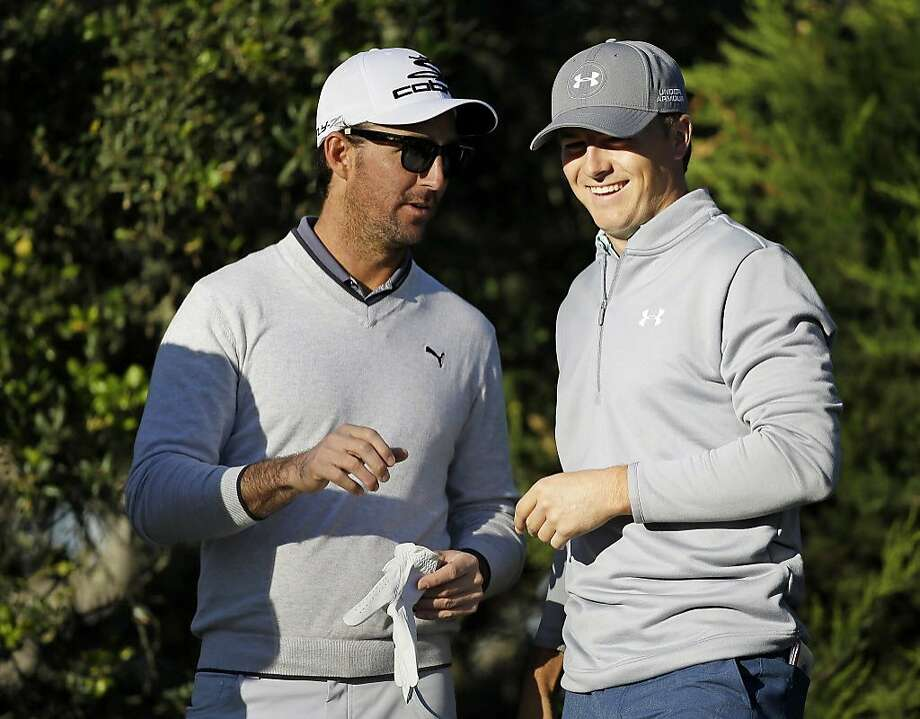 """FILE- In this Feb. 2, 2015, file photo, country music star Jake Owen, left, talks with his playing partner Jordan Spieth, right, on the third tee of the Monterey Peninsula Country Club Shore Course during the first round of the AT&T Pebble Beach National Pro-Am golf tournament in Pebble Beach, Calif. Some see this tournament as a burden. The rounds can approach six hours because they are played in foursomes with amateurs. Spieth, who has played the last two times with Owen, says """"This week, it's so unique and it's so much fun."""" (AP Photo/Eric Risberg, File) Photo: Eric Risberg, Associated Press"""