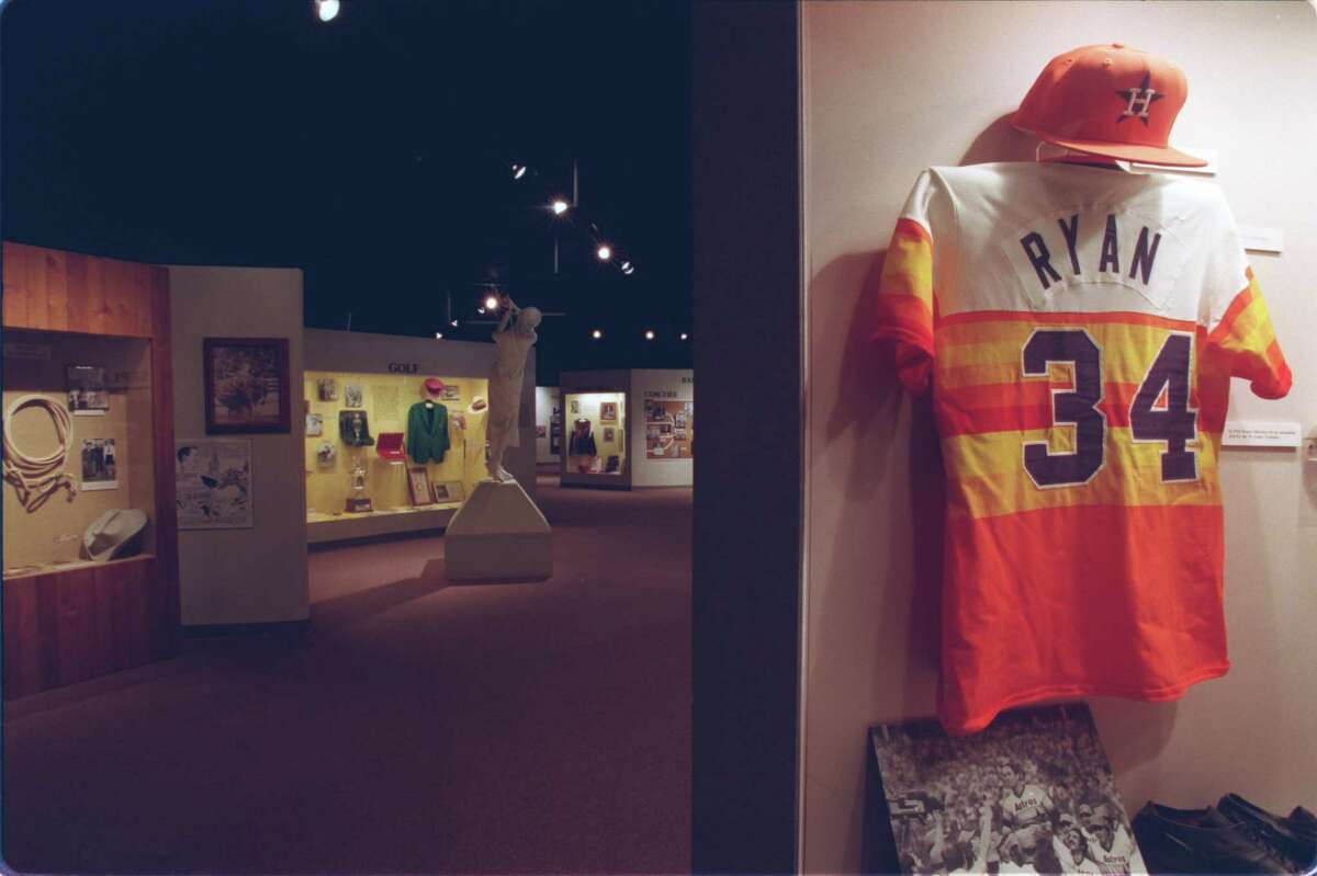Texas Sports Hall of Fame Nolan Ryan's Astro jersey and hat in the major league baseball exhibits 01/21/99 HOUCHRON CAPTION (01/24/1999): Nolan Ryan's exhibit in the Texas Sports Hall of Fame includes his No. 34 jersey, featuring the rainbow colors of the Houston Astros.