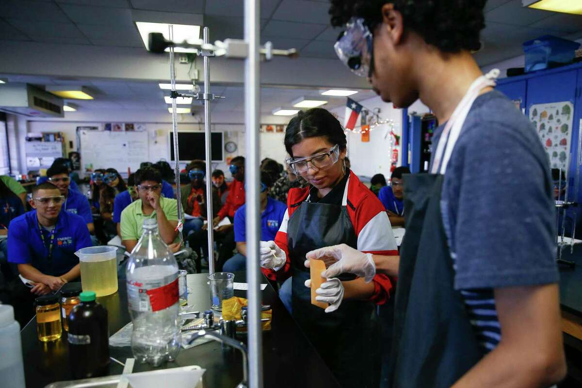 Juniors Deborah Marin, left, and Charles Hendricks help perform an experiment during a presentation on biodiesel during their joint environmental science and bio-tech engineering class at the Energy Institute High School, a STEM-focused magnet school in Houston ISD, Tuesday, Jan. 30, 2018 in Houston. ( Michael Ciaglo / Houston Chronicle)