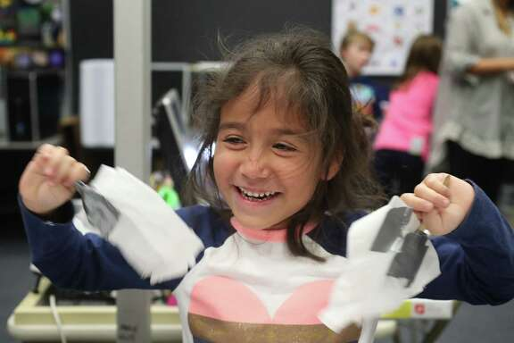 Ed White E-STEM Elementary first-grader Aliana Newswander cools herself with the windmill blades she designed Wednesday, Jan. 24, 2018, in El Lago. STEM education is an immersive experience from the classroom to the lab to the library for students at Clear Creek ISD Ed White Elementary in El Lago. In the engineering lab, the first graders are building and testing windmills while the fifth graders are building a dam to watch a water release, potential innovation to advise those who run water basins and gates that could cause or prevent flooding like in Hurricane Harvey. ( Steve Gonzales / Houston Chronicle )