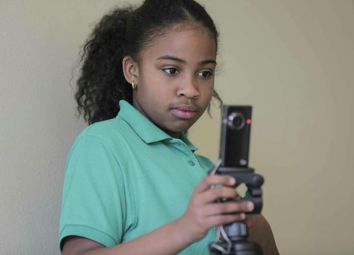 Elle Hamm, 10, films her classmates demonstrating their coding a robot skills at Harvard Elementary School on Wednesday, Jan. 24, 2018, in Houston. ( Elizabeth Conley / Houston Chronicle )