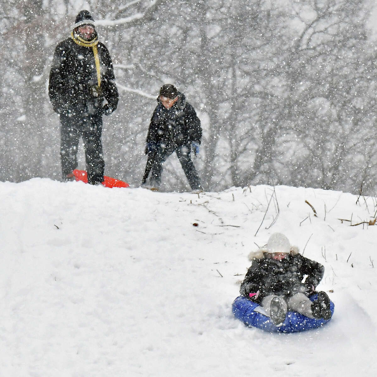 Dannie Chapman, left, of Albany, takes his son Yusuf, 6, and daughter Hafsa, right, 11 sledding as snow continues to fall in Frear Park Wednesday Feb. 7, 2018 in Troy, NY. (John Carl D'Annibale/Times Union)