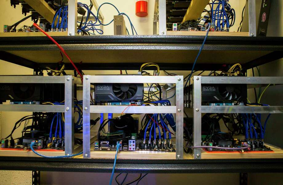 Cryptocurrency mining rigs sit in a server room inside the Snapstream offices, Wednesday, Jan. 24, 2018, in Houston. Rakesh Agrawal's company is building cryptocurrency mining rigs that use high powered video cards as their base. ( Mark Mulligan / Houston Chronicle ) Photo: Mark Mulligan, Houston Chronicle / © 2018 Houston Chronicle