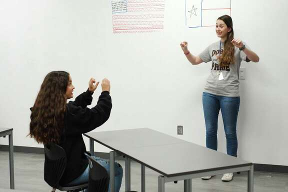 Kristen Barba practices sign language in class with teacher Caitlin O'Connell at the new Pasadena ISD Dobie 9 campus Friday, Feb 2.
