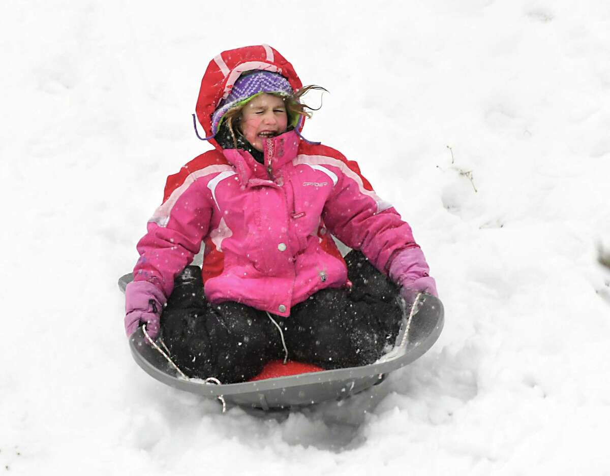 Tilly Lamont, 6 of Albany braves a steep hill in Washington Park during a snow storm on Wednesday, Feb. 7, 2018 in Albany, N.Y. (Lori Van Buren/Times Union)