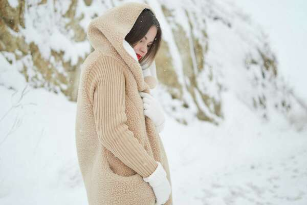 A faux-sherpa-lined sweater and a pop of color keeep an outfit warm yet stylish.