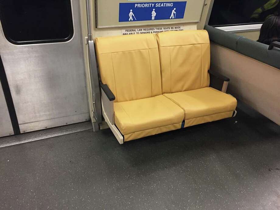 BART has begun swapping out the fabric for priority seating on all train cars with a light brownish yellow, in lieu of the standard greenish blue. Photo: BART