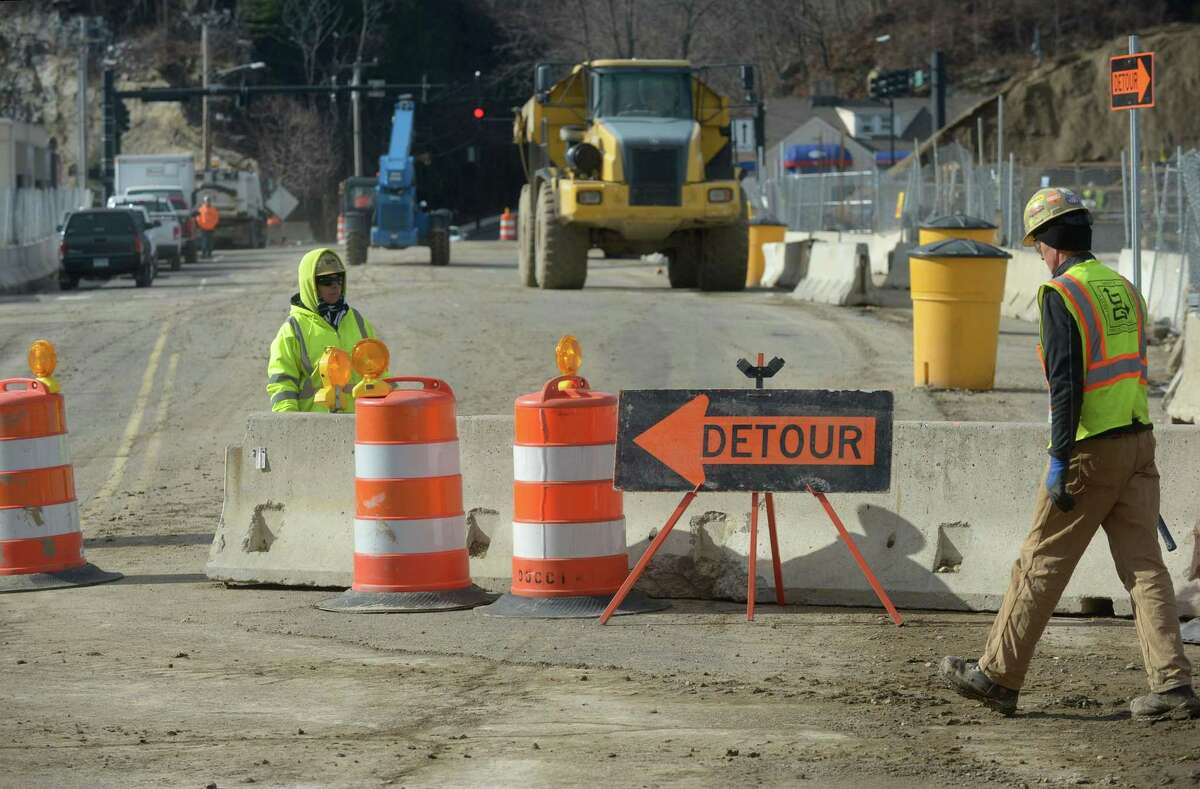 Construction workers with General Growth Properties close North Water Street Wednesday, January 24, 2018, from the Metro-North overpass to West Ave until May of this year during the construction of the SoNo Collection Mall in Norwalk, Conn. A detour through the construction site to Putnam Ave extension will give motorists and pedestrians on North Water Street access to West Ave.