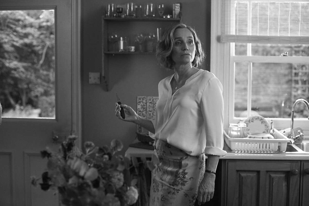 Government minister Janet (Kristin Scott Thomas) tries to hold it together during an unruly party at her home in