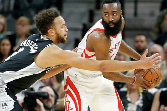 San Antonio Spursé• Kyle Anderson defends Houston Rocketsé• James Harden during first half action Thursday Feb. 1, 2018 at the AT&T Center.