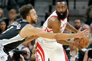 San Antonio Spurs Kyle Anderson defends Houston Rockets James Harden during first half action Thursday Feb. 1, 2018 at the AT&T Center.