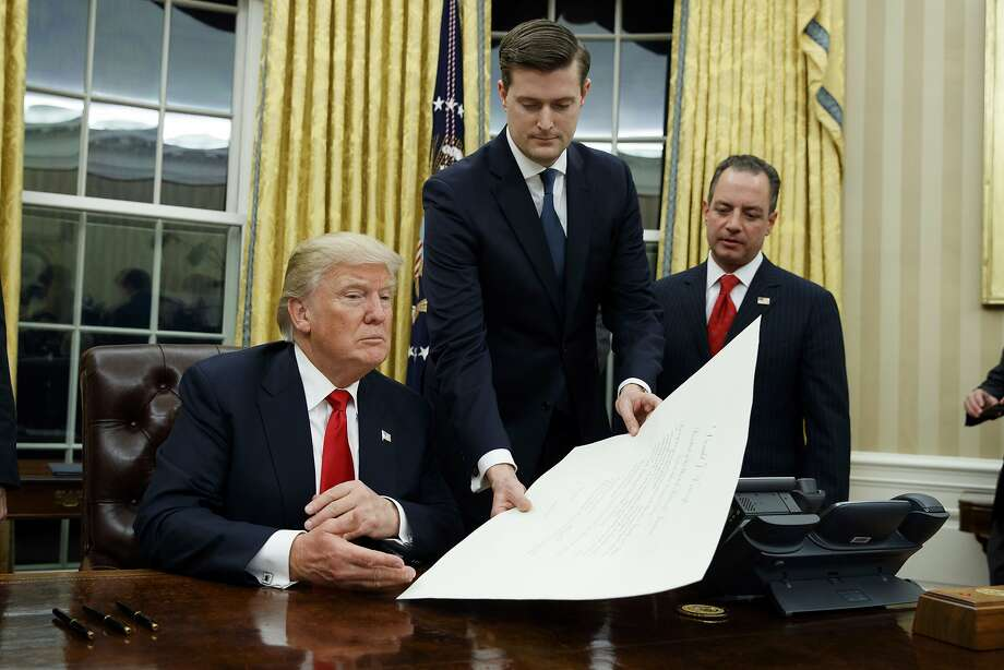 Staff Secretary Rob Porter (center) helped control the flow of information to President Trump. Photo: Evan Vucci, Associated Press