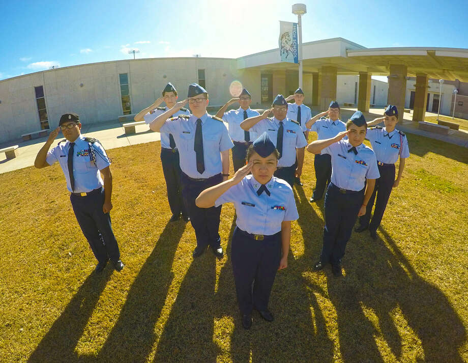 "The instructors and cadets of Lamar Consolidated High School's Air Force Junior ROTC recently earned an overall unit assessment score of  ""Exceeds Standards,"" the highest rating attainable by a JROTC program. From left are: front: Cadet Maeseille Calonia; second row: Cadets Jesus Lopez, Christopher Coats, Manuel Arriaga, Carolina Garcia and Adrianna Rios; third row: Cadets Matthew Alfaro, Azahel Vazquez, Julian Vinsonhaler and Isabel Arviso. Photo: Lamar Consolidated High School"