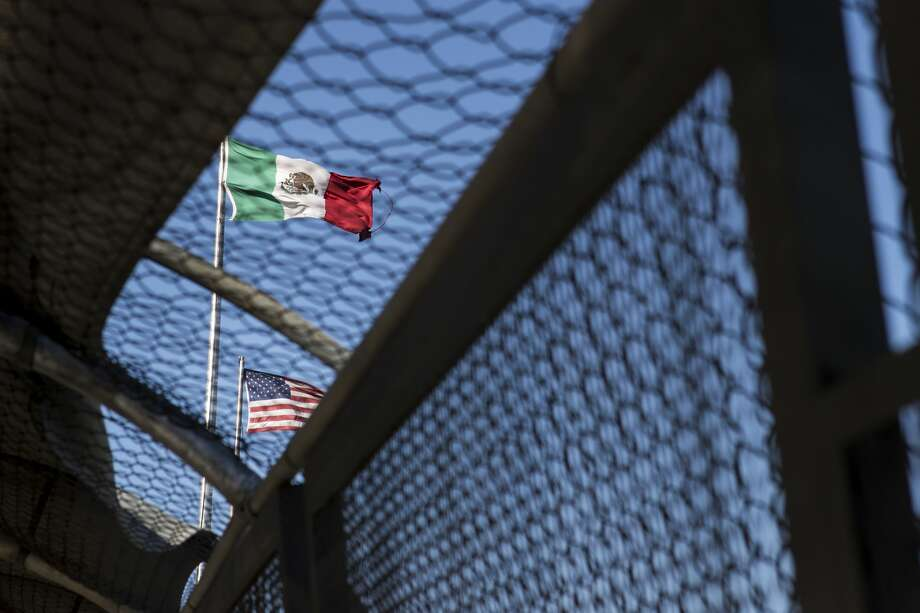 "The flags of the United States and Mexico fly over the border above the Paso del Norte Bridge also known as the ""Santa Fe Street Bridge,"" on Wednesday, Jan. 31, 2018, in Ciudad Juarez, Mexico. ( Brett Coomer / Houston Chronicle ) Photo: Brett Coomer/Houston Chronicle"