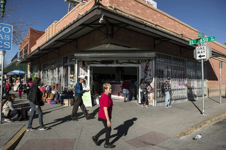Shoppers walk along El Paso Street outside the collection of shops on the United States side of the border on Wednesday, Jan. 31, 2018, in El Paso, Texas. ( Brett Coomer / Houston Chronicle ) Photo: Brett Coomer/Houston Chronicle