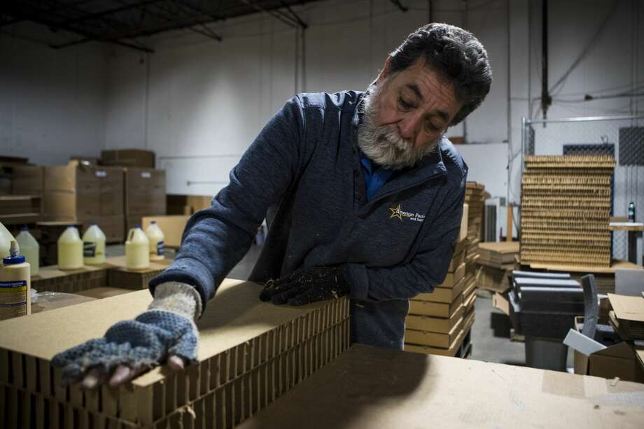 Manuel Gomez builds shipping containers at American Packging and Supply, Inc., on Thursday, Feb. 1, 2018, in El Paso, Texas. ( Brett Coomer / Houston Chronicle ) Photo: Brett Coomer/Houston Chronicle