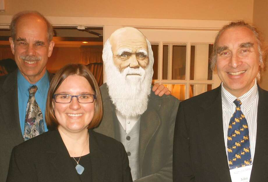Southern Connecticut Darwin Day Committee Co-Chairman Cary S. Shaw and Chairman John Levin pose with Rene Almeling, a Yale University sociologist who previously spoke at the Darwin Day Dinner, and a life-size image of the naturalist. Photo: Contributed Photo / Westport News contributed