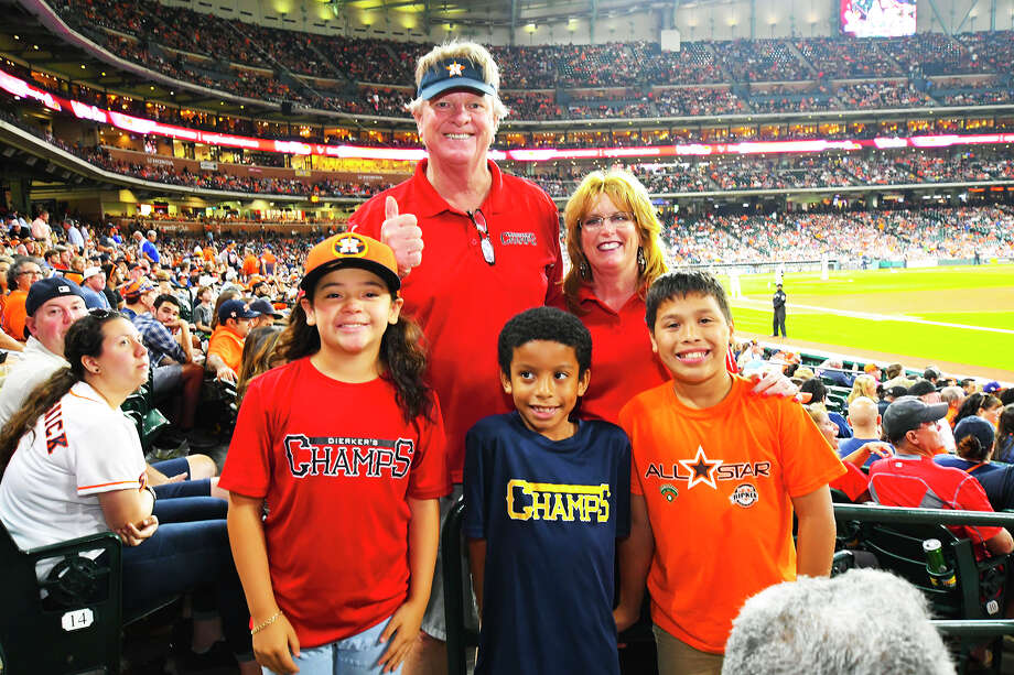 Three of the Dierker's Champs participants (front row, left to right: Brianna Magallanes, Holbrook; Jayce Wilson, Francone; Daniel Artola, Matzke) posed last year with legendary Astros manager, pitcher and broadcaster Larry Dierker and Program Director Sheri Lee at an Astros game. Photo: Tony Gaines / HCN