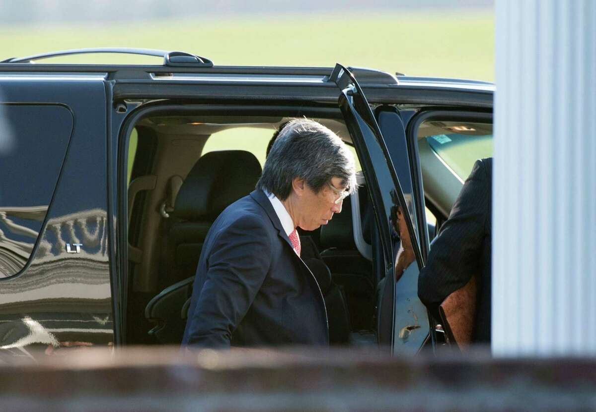 In this photo taken on November 19, 2016 South African surgeon Patrick Soon-Shiong enters the clubhouse at Trump National Golf Club for a meeting with US President-elect Doanld Trump November 19, 2016 in Bedminster, New Jersey. The Los Angeles Times is being sold to billionaire physician and investor Patrick Soon-Shiong in a move aimed at reviving the fortunes of the newspaper amid recent turmoil. Publishing group Tronc Inc. said it reached a deal to sell the LA Times and San Diego Union-Tribune to Soon-Shiong's Nant Capital for $500 million plus the assumption of $90 million in pension liabilities.