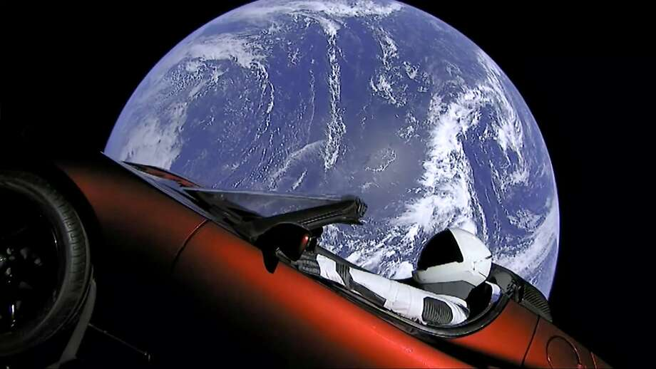 This image from video provided by SpaceX shows the company's spacesuit in Elon Musk's red Tesla sports car which was launched into space during the first test flight of the Falcon Heavy rocket on Tuesday, Feb. 6, 2018. (SpaceX via AP) Photo: Associated Press