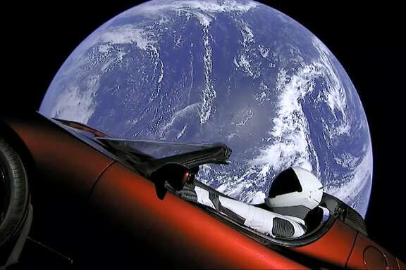 This image from video provided by SpaceX shows the company's spacesuit in Elon Musk's red Tesla sports car which was launched into space during the first test flight of the Falcon Heavy rocket on Tuesday, Feb. 6, 2018. (SpaceX via AP)