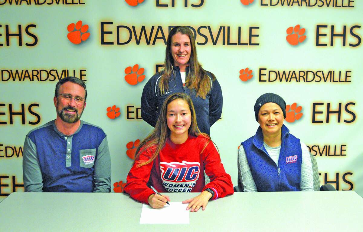 Edwardsville senior Megan Bowman will play soccer at the University of Illinois-Chicago. In the front row, from left to right, are father Steve Bowman, Megan Bowman and mother Maria Bowman. EHS coach Abby Federmann is in the back.