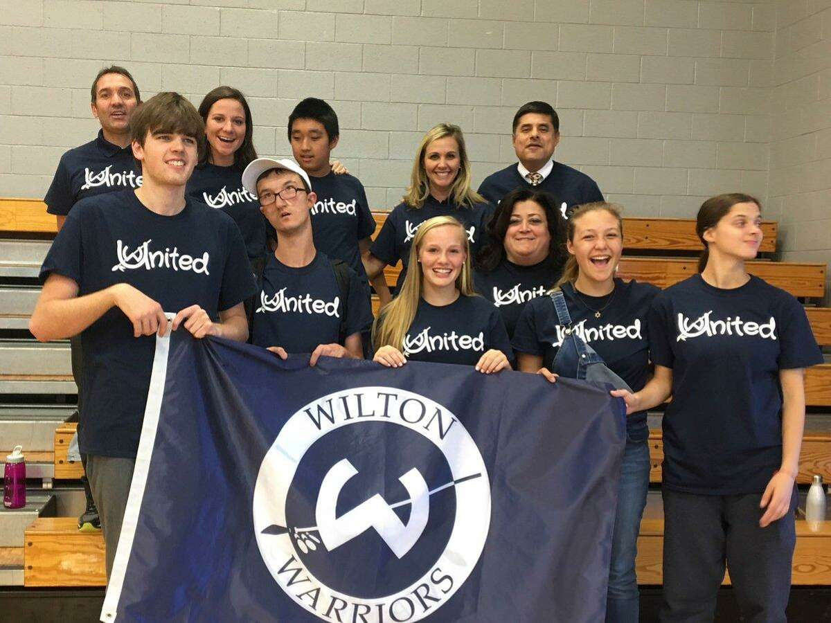Wilton Assistant Superintendent of Special Services Andrea Leonardi (middle row) with students from Wilton High School.