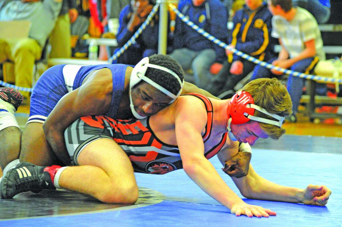 Edwardsville senior Dylan Wright wrestles in a 132-pound match at the Quincy Regional. Wright finished third in the regional to advance to the Alton Sectional.