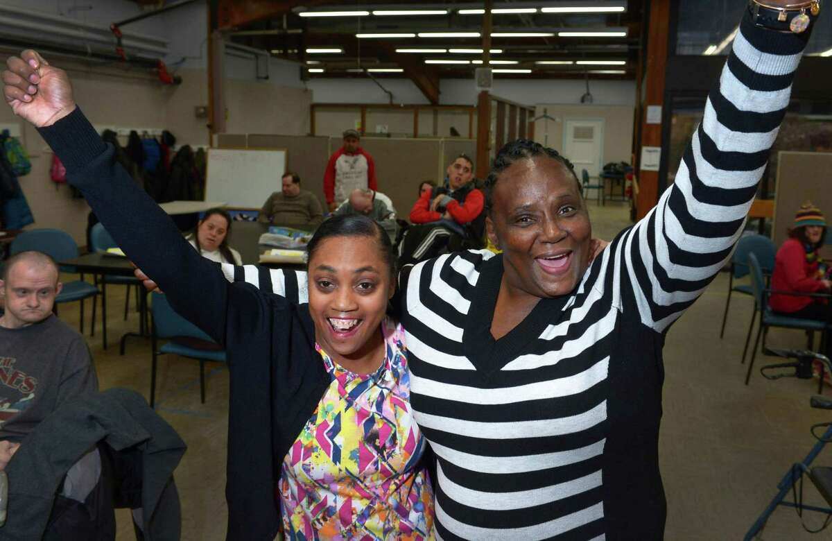 STAR clients Angie Daniels and Trish Elmore were surprised by the news they were granted trips by the Friends of G Foundation while at STAR in Norwalk on Wednesday. Daniels received her lifelong wish with a trip to Disney World and Elmore a trip to Camp Horizons in upstate Connecticut.