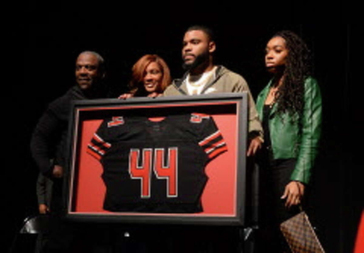 Elandon Roberts, center, and his family during the retiring ceremony for his jersey at Memorial High School Wednesday. Roberts started at linebacker in Super Bowl LII. Photo taken Wednesday, February 07, 2018 Guiseppe Barranco/The Enterprise