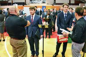 RPI students Nathan Jones, left facing camera, of New Bedford, Mass., and Ethan Tebben of Pittsfield, Mass., speak with Raytheon representatives as Rensselaer Polytechnic Institute Center for Career and Professional Development hosts its Spring Career Fair Wednesday Feb. 7, 2018 in Troy, NY.  (John Carl D'Annibale/Times Union)