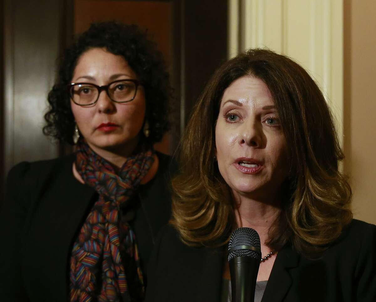 Assemblywoman Melissa Melendez, R-Lake Elsinore, right, and Assemblywoman Cristina Garcia, left, meet with reporters after the Assembly approved their bill to provide whistleblower protection for legislative staff members, Monday, Feb. 5, 2018, in Sacramento, Calif. If signed by Gov. Jerry Brown, the bill, AB403, will take effect immediately. (AP Photo/Rich Pedroncelli)